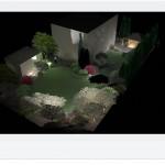 Zaprojektowany ogród nocą - widok ogólny.