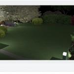 Obrzeże rozległego trawnika wieczorem dyskretnie podkreślają lampy ogrodowe.